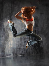 Image Redhead girl Dance Jump Smile Legs Jeans young woman