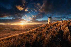 Fotos Sonnenaufgänge und Sonnenuntergänge Himmel Grünland Spanien Lichtstrahl Sonne Mühle