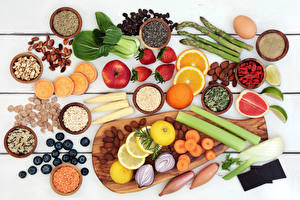 Photo Vegetables Fruit Spices Nuts Strawberry Apples Citrus Blueberries Wood planks Cutting board Grain