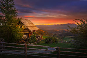 Photo Austria Houses Sunrise and sunset Spruce Fence Wooden Magdalensberg Cities