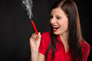 Pictures Chili pepper Black background Brown haired Laughter Smoke Girls
