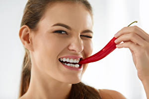Pictures Chili pepper Fingers White background Brown haired Teeth Girls