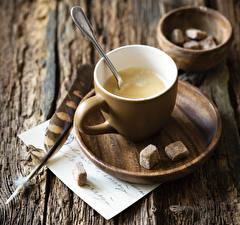 Bilder Kaffee Cappuccino Federn Bretter Tasse Zucker Untertasse Lebensmittel