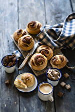 Image Coffee Cappuccino Pastry Cinnamon Buns Wood planks Cup Sugar