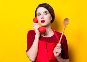 Pictures Colored background Brown haired Phone Spoon Red lips Hands young woman