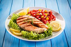 Photo Fish - Food Vegetables Lemons Salmon Wood planks Plate