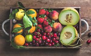Bilder Obst Melone Orange Frucht Kirsche Erdbeeren Zitrone Limette das Essen