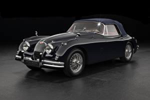Bilder Jaguar Retro Grauer Hintergrund Coupe Schwarz Metallisch 1958-61 XK150 Drophead Coupe automobil