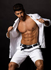 Pictures Man Black background Muscle Shorts Beautiful Belly
