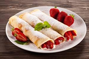 Fondos de Pantalla Panqueque Azúcar glas Fresas Plato Alimentos