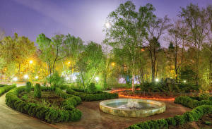 Fotos Russland Parks Frühling Springbrunnen Abend Bäume Strauch Straßenlaterne Sakhalin Natur