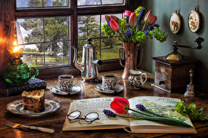 Wallpapers Still-life Tulips Hyacinths Paraffin lamp Kettle Coffee Torte Vase Cup Eyeglasses Plate Piece Food Flowers