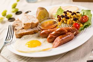 Picture Vienna sausage Fried egg Plate Fork Breakfast Food
