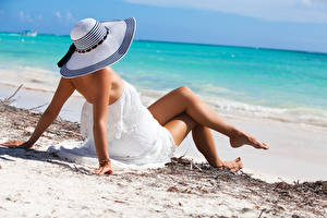 Pictures Beach Hat Frock Legs Hands Laying Pose female
