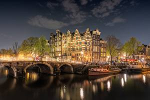 Photo Bridges Amsterdam Netherlands Riverboat Houses Rivers Night Canal Cities