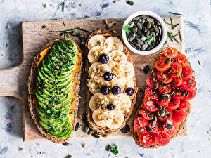 Pictures Butterbrot Tomatoes Bananas Avocado Cutting board Three 3 Food