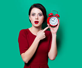 Pictures Clock Fingers Alarm clock Colored background Brunette girl Staring Red lips Girls