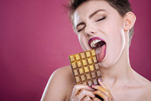Photo Chocolate Fingers Chocolate bar Colored background Brown haired Tongue Girls
