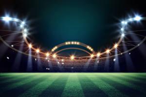 Bilder Fußball Abend Stadion Rasen Lichtstrahl sportliches
