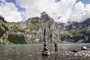 Picture Lake Stones Mountains Switzerland Cliff lake Oeschinen