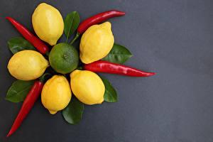 Image Lemons Chili pepper Gray background Foliage