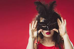 Images Masks Feathers Red background Hands Girls