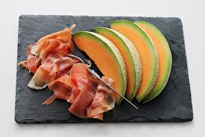 Photo Melons Meat products Bacon Sliced food Cutting board Fork Food
