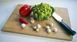 Fotos Paprika Messer Pilze Kohl Zucht-Champignon Schneidebrett Lebensmittel