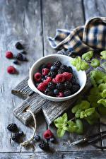 Image Raspberry Blackberry Blueberries Boards Cutting board Foliage Bowl Food