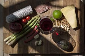 Image Sausage Cheese Chili pepper Allium sativum Wine Sliced food Stemware Cutting board Food