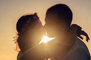 Pictures Sunrises and sunsets Man Couples in love Silhouette 2 Kissing Hug Girls