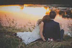Pictures Sunrise and sunset Man Lovers Grass Two Sit Grooms Brides Wedding female