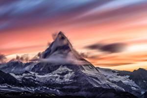 Fotos Sonnenaufgänge und Sonnenuntergänge Gebirge Schweiz Wolke Schnee Matterhorn, Zermatt Natur