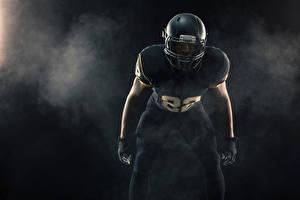Photo American football Man Uniform Helmet
