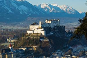 Pictures Austria Mountain Castles Houses Fortification Snow Salzburg Cities