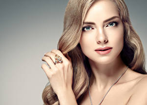 Pictures Gray background Face Staring Hands Ring Dark Blonde young woman
