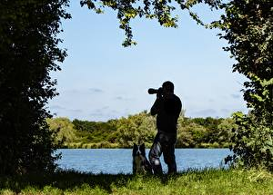 Pictures Lake Dogs Men Grass Photographer Nature
