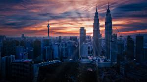 Picture Malaysia Skyscrapers Sunrise and sunset Megalopolis Kuala Lumpur Petronas Twin Towers Cities