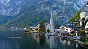 Bilder Gebirge See Motorboot Kirchengebäude Herbst Österreich Hallstatt Gmunden County, Lake Hallstatt Städte