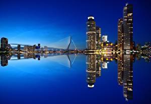 Image Netherlands Sunrises and sunsets Evening Skyscrapers Bridges Reflection Rotterdam, Nieuwe Maas river Cities