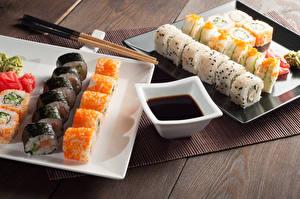 Fotos Meeresfrüchte Sushi Reis Essstäbchen Schüssel Sojasauce