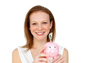 Bilder Weißer hintergrund Lächeln Sparschwein Starren Rotschopf Gesicht Mädchens