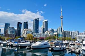 Fotos Kanada Wolkenkratzer Bootssteg Motorboot Türme Megalopolis Toronto, province of Ontario, CN Tower Städte
