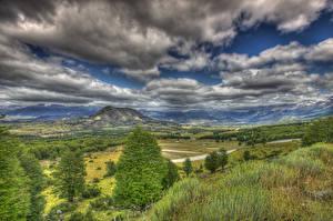 Bilder Chile Landschaftsfotografie Gebirge Wald Grünland Himmel Wolke Gras HDRI Patagonia Natur
