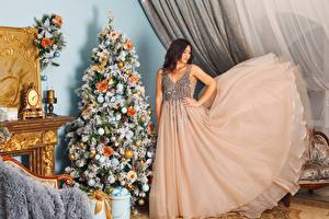Images New year Holidays Christmas tree Brown haired Gown