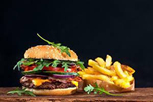Wallpapers Fast food Hamburger Buns Finger chips Vegetables Black background