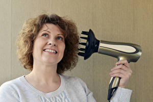 Wallpapers Fingers Adult woman Brown haired Hair Smile Hairdryer