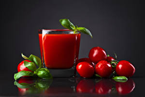 Pictures Juice Tomatoes Gray background Highball glass Drops Leaf Food