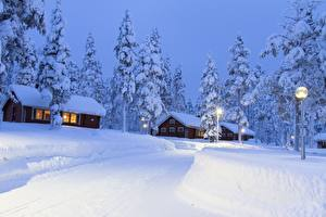 Picture Lapland region Finland Houses Snow Spruce Street lights Cities