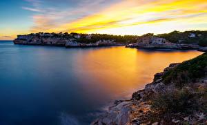 Desktop hintergrundbilder Mallorca Morgendämmerung und Sonnenuntergang Küste Bucht Felsen Mirador Es Pontas Natur